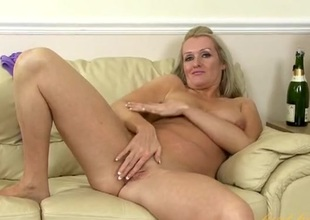 Beautiful mature blonde with a sexy shaved pussy