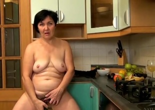 Fruits and veggies pleasure her wet grown-up pussy