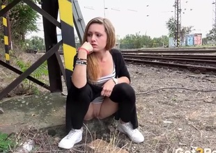 Girl takes a piss by be passed on season tracks
