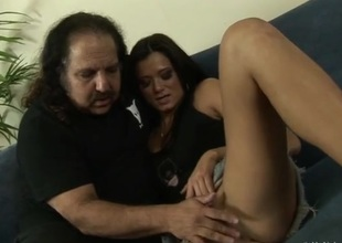 Ron Jeremy watches a sustenance cutie get undressed be required of him