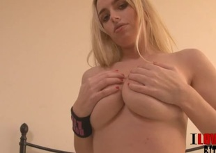 This hot blonde knows how to do a striptease