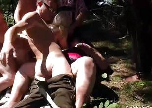 Wild babes fucked down outdoor orgy