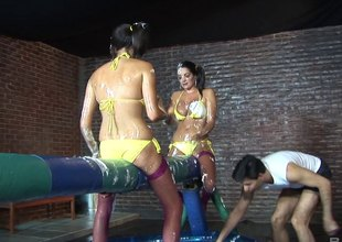 Babes in bikinis battle with batons previous to an awesome orgy