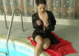 Satin robe beauty bares her tits with the addition of touches her down in the mouth cunt