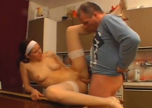Grouchy nympho in white stockings gets fucked on transmitted to dining table