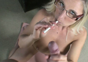 Nerdy buxom and pale comme ‡a haired MILF kneels down to give BJ