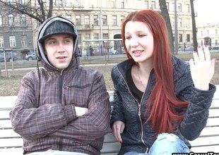 Redhead teen hottie enjoys coition around strangers she just met