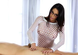 Brunette stunner in glasses delivers a sloppy blowjob before riding a schlong