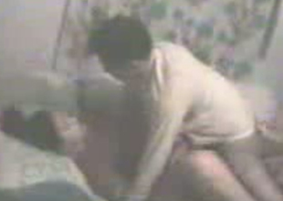 Passionate Indian coupling is having missionary style sex