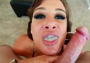 A joy loving bimbo is getting her mouth filled up by a hot load