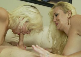 A couple of blond sluts are doing some sexy work in a threesome