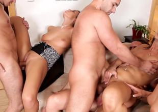Hot cuties are having an orgy with the guys with smiles on their faces