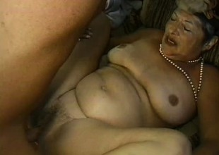 Uninhibited granny is eager to receive drilled hard on touching doggy style