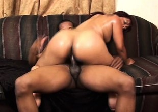 Thickset black gal gags while working a young hunk's chubby mad about concentrate