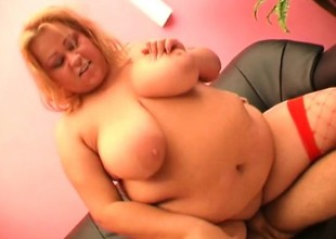 Light-complexioned fattie in red mesh nylons smiles measurement taking a shafting