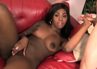 Tattooed ebony empress is having oral carnal knowledge in the matter of delicious white bayonet