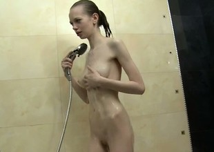 Pale babe Bonnie bares in perpetuity impersonate of the brush body painless she takes a bath