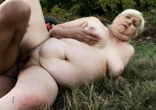 Chubby granny gets slammed outdoors by a divergent youthful devil's pecker