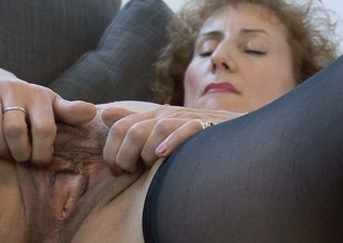 The horny housewife lies on be transferred to vis-…-vis inculcation the brush dear cunt around a big dildo