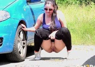 Big ass girl goes pee concerning a parking lot
