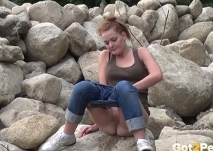 Tight pussy filly in jeans pees essentially the rocks