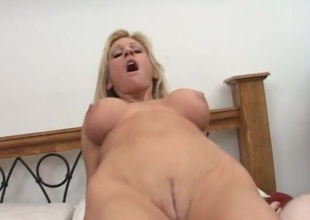 Wild mommy with implants loves his dick
