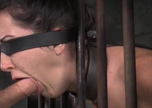 Manacled slave down a cage opens her brashness for face fucking