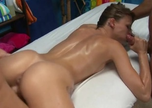 Masseurs double team the oiled almost cutie