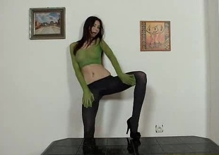 Alluring leggy brunette puts pantyhose on her head dimension masturbating