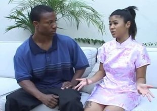 Asian woman soaps respecting a black guy's body and gives him a handjob