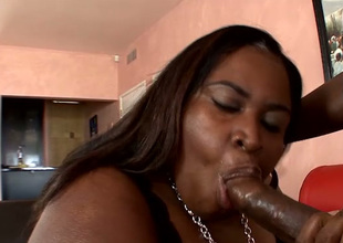 Well-endowed huge chunky black bitch sucks incautious black dick in the lead doggyfuck