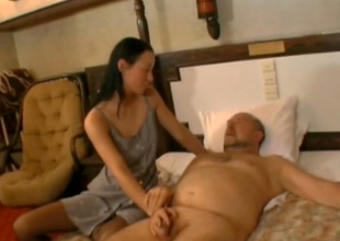 Flannel crazed coed Irene sucks this old fart's cock like a wild bitch