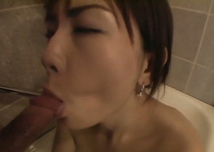 Cute Japanese gal does her best to the fullest extent a finally sucking lollicock on foamy bath