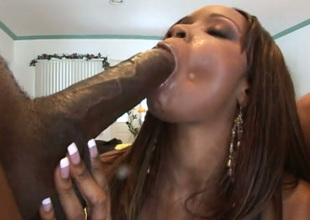 Plump black chick in knee overbearing boots worships two big cocks like a boss