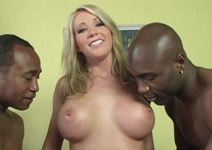 Foxy cowgirl enjoys a threesome, she has two black cocks
