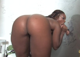 Glamorous ebony roughly big tits giving big schlong handjob during the time that displaying her black butt