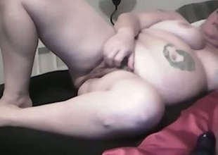 My fat tattooed join in matrimony toys her cunt to orgasm indoors