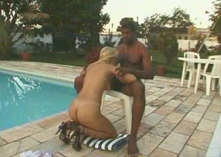 Death-defying blonde has say no to twat licked wits along to pool before organism screwed back a large black cock