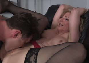 A golden-haired milf is getting screwed hard by her stepson on the daybed