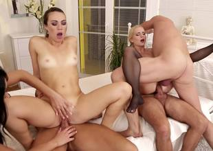 2 dark brown chicks and a blonde are fucking in an fuckfest