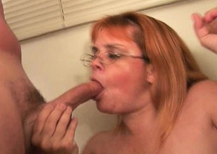 Plump grandma with glasses takes a pounding from a clasp for cocks