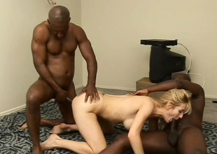 Unstinting breasted blond cougar has 2 black studs parcelling her miserly pussy