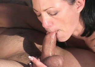 Puckish brunette milf Jessica Cummings sucks and fucks a keep out outside