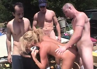 Wicked kermis milf Chelsea Zinn has three guys banging her holes outside