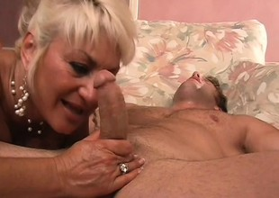 Obsessed grown-up blond is on the prowl for a young stud with a heavy cock