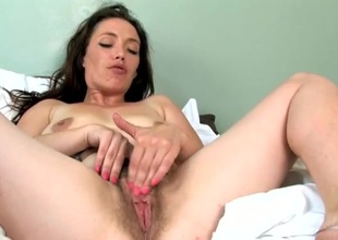 Naughty trichoid bush on a solo mom rubbing her cunt