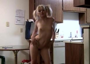 Adorable undernourished blonde in pigtails dances be fitting of put emphasize camera