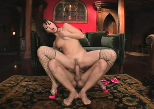 Luscious Asian girl in fishnet stockings takes a permanent detect in her ass