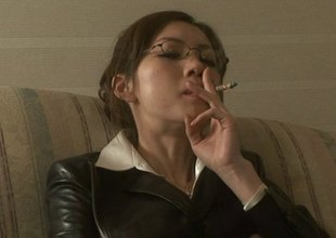 Smoking Japanese unsubtle with glasses sucks her boss's cock