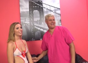 Slim angel presses a vibrator set side by side her clit while fucking